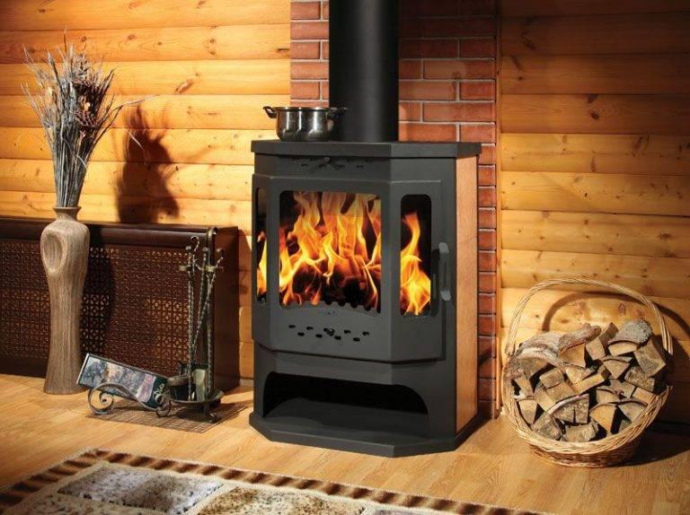 Дровяные чугунные печи длительного горения для дачи: разновидности, описание и отопление дома с их помощью
