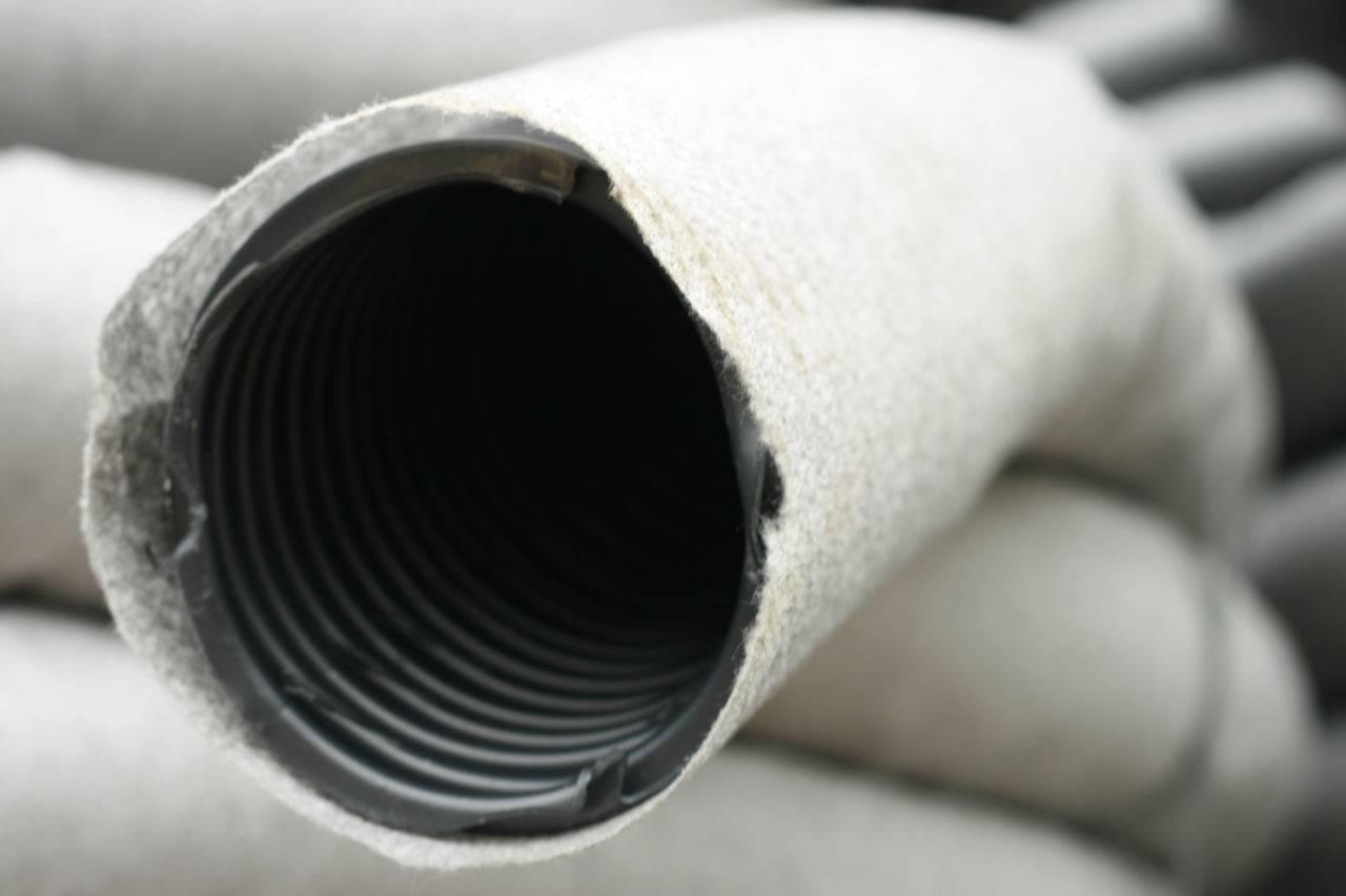 Труба перфорированная металлическая: свойства и условия применения