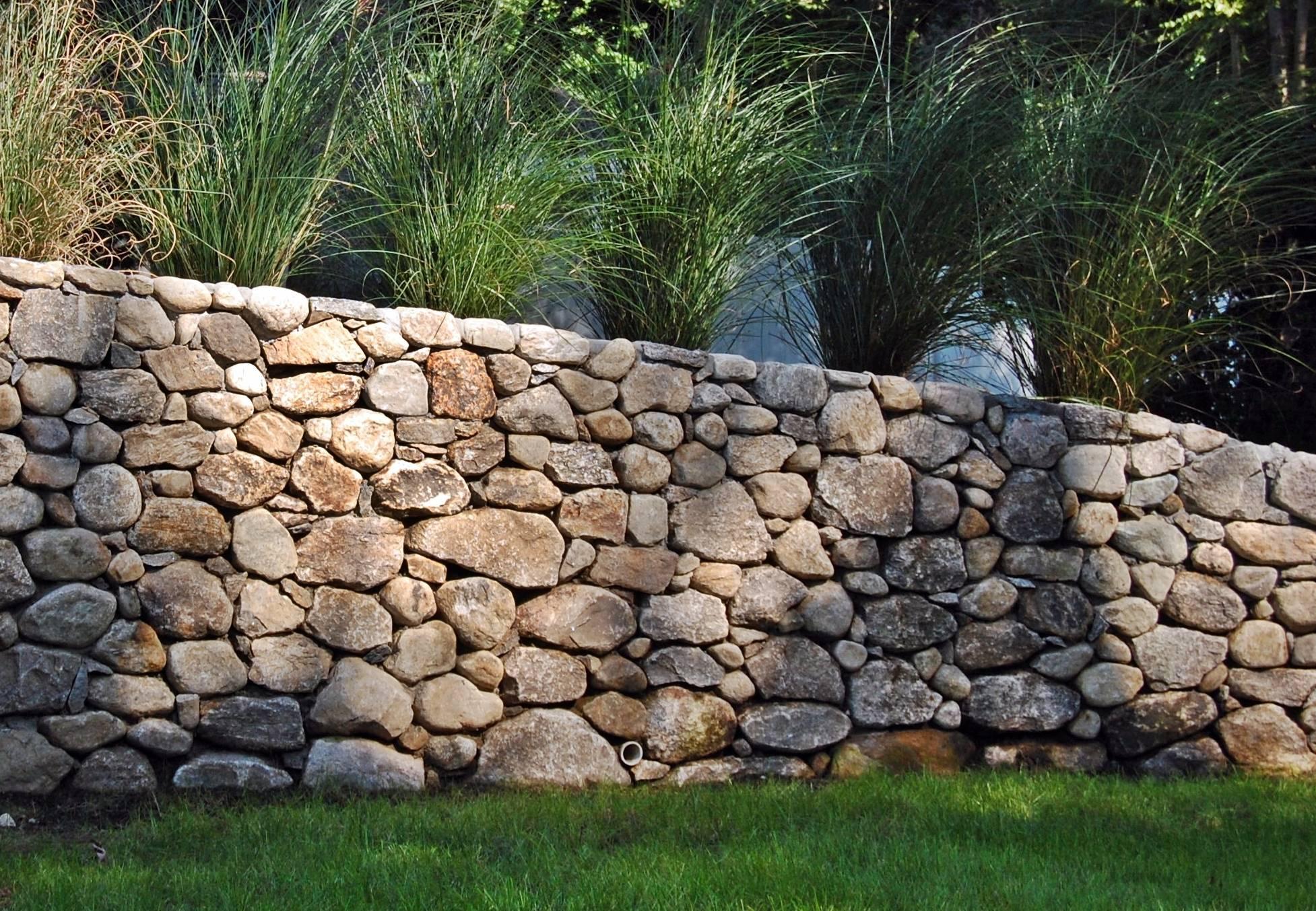 Самостоятельное строительство каменного забора — разновидности камней