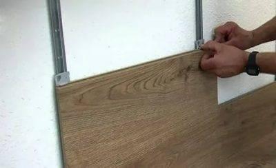 Ламинат на стену: преимущества/ недостатки, применение
