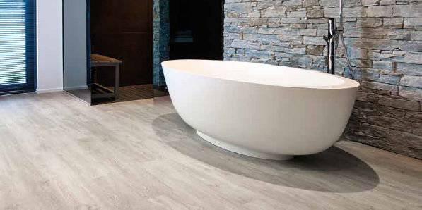 Кварцвиниловая плитка для пола и стен: напольное покрытие в ванной, на кухне, укладка в комнатах, минусы, фото, видео