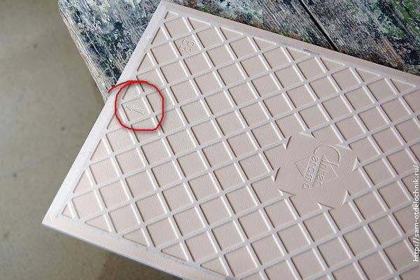 Что обозначает стрелка на обратной стороне плитки?  - строительство и ремонт - вопросы и ответы