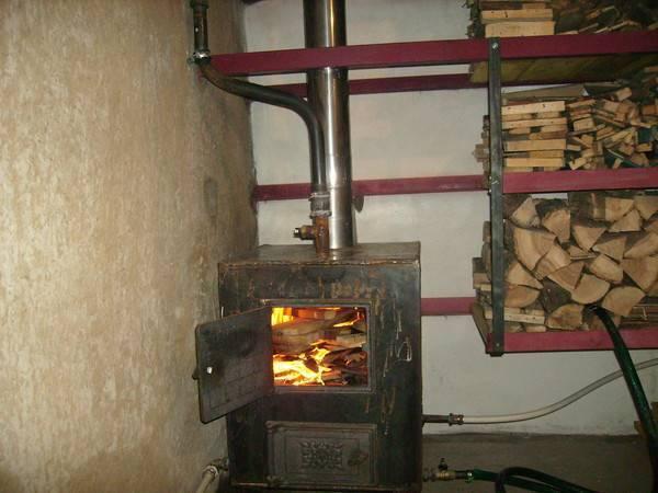 Организация отопления многокомнатных домов с помощью печей на дровах
