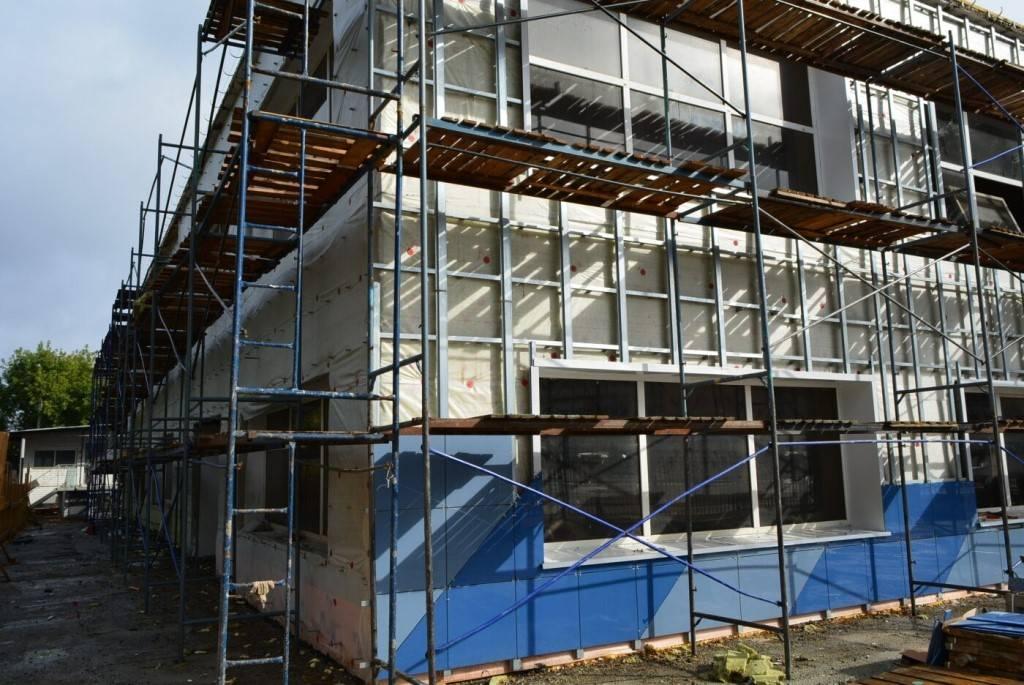 Как правильно делается капитальный ремонт фасада здания и что в него входит