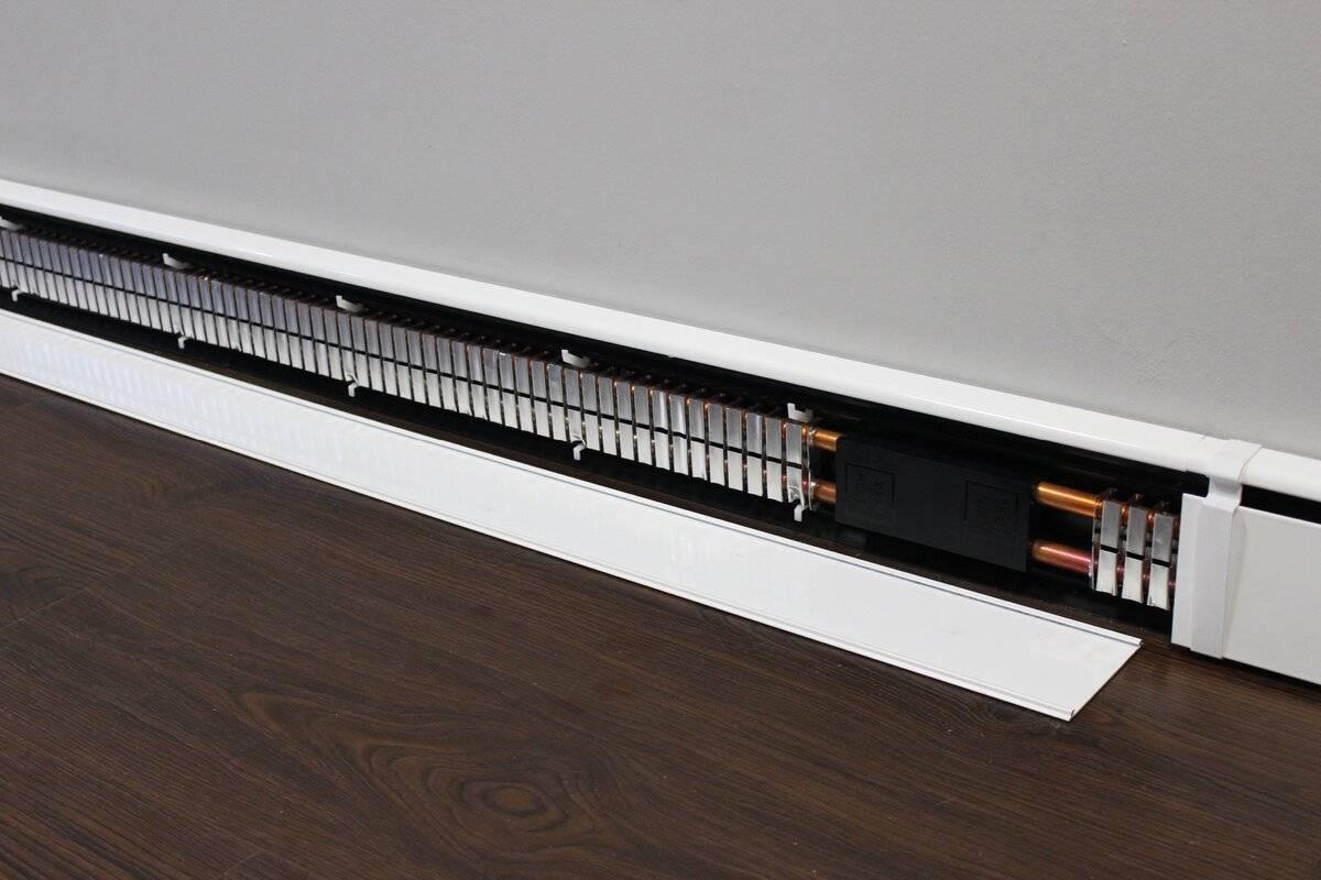 Отопление дома теплым плинтусом — отличие от радиаторов и теплого пола.